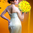Gorgeous young redhead woman with bouquet of flowers — Stock Photo
