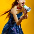 Young woman with megaphone — Stock Photo #5127669