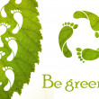 Footprint recycle sign and green leaf — Stock Photo