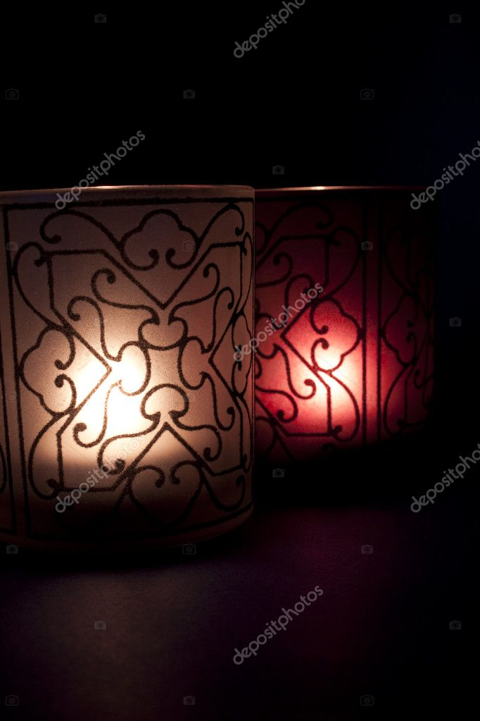 Stylized candles with light of hope in the darkness — Stock Photo #4664526