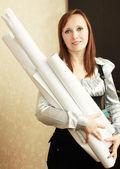 Woman holding blueprints — Stock Photo