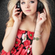 Blond listens to music — Stock Photo