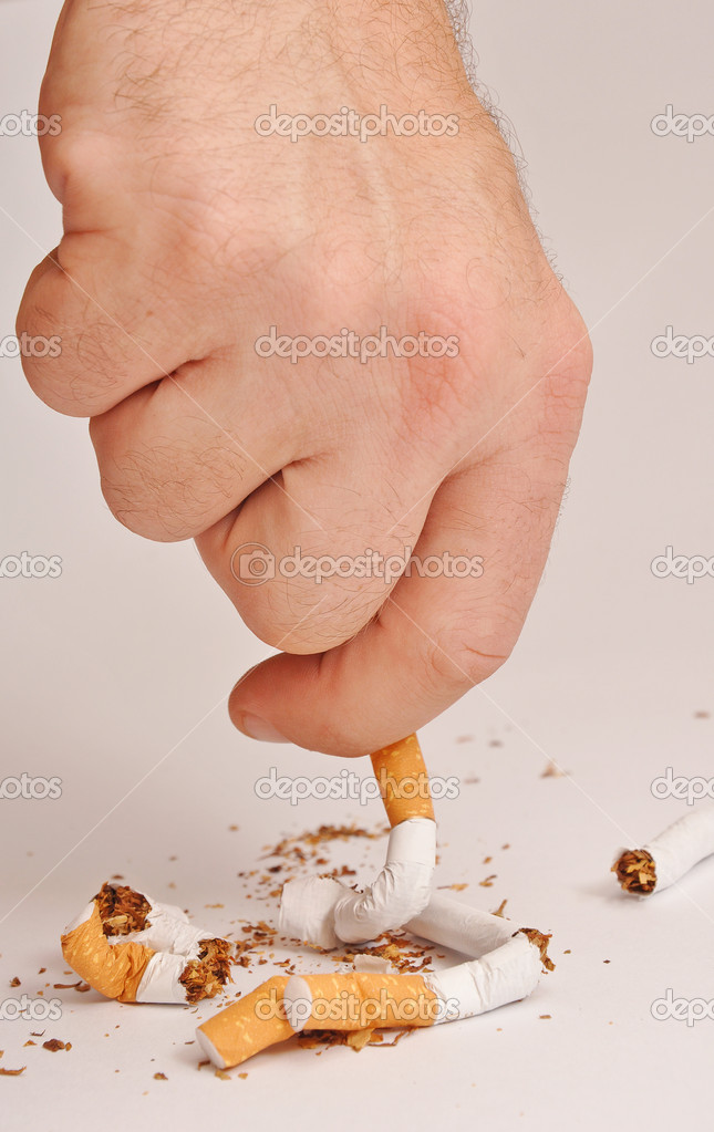 Hand man crushes last cigarette. stop smoking — Stock Photo #3933329