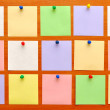 Bulletin board with colorful paper notes — Stock Photo #3980752
