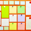 Bulletin board with colorful paper notes — Stock Photo #3981442