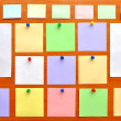 Stock Photo: Bulletin board with colorful paper notes