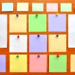 Bulletin board with colorful paper notes — Stock Photo