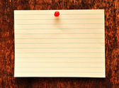Blank adhesive note note against old wood background — Stock fotografie
