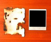 Old photos and burnt paper — Stock Photo