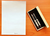 Pens and blank paper for signature — Stok fotoğraf