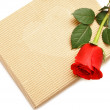 Red rose and gift box — Stock Photo