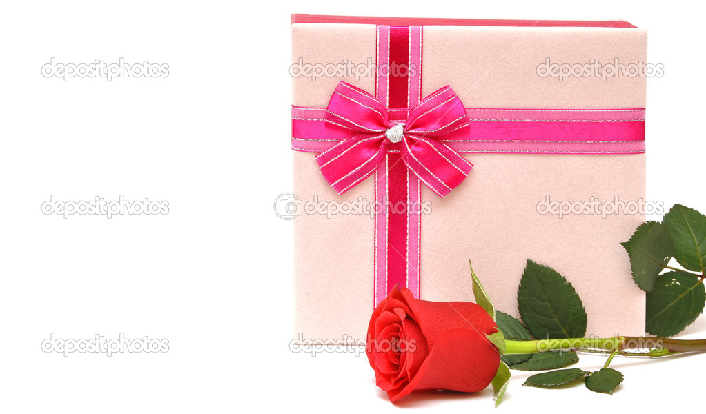 Beautiful red rose and present with ribbon. space for your text — Stock Photo #4177621