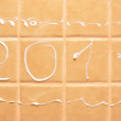 "Word ""2011"" made of foam on wall — Stockfoto"