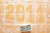 "Word ""2011"" made of foam on wall — Stock Photo"