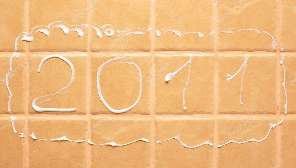 Word 2011 made of foam on wall tile — Stock Photo #4237387
