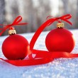 Red glass christmas balls on background snow — Stock Photo