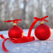 Red glass christmas balls on background snow — Stock Photo #4295079