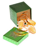 Christmas gift box and cones — Stock Photo