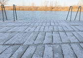 Pier with fresh layer of snow — Stock Photo