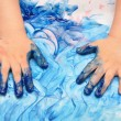 Foto Stock: Child hands painted in blue paint