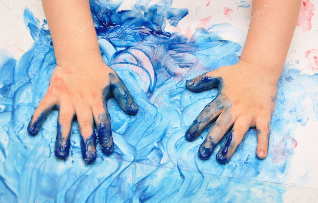 Child hands painted in blue paint ready for hand prints — Stock Photo #4318255