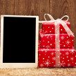 Christmas gift boxes and old empty photo — Stock Photo #4359277
