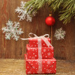 Christmas presents in wood background — Stock Photo