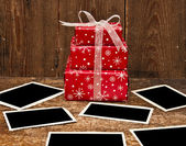 Christmas gift boxes and old empty photos — Stock Photo