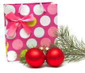 Gift bag and New Year's balls — Stock Photo
