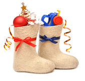 Children's boots with gifts — Stock Photo