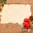Christmas decoration and old paper — Stock Photo