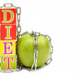 Green apple and cubes with letters - diet, on white