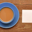 Blank card on coffee cup — Stock Photo