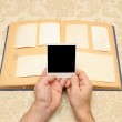 Male hands on an old vintage photo album — Stock Photo #4573457