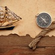 Old paper, compass, rope and model classic boat on wood backgrou — Stock Photo #4601731