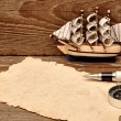 Old paper, compass, rope and model classic boat on wood backgrou — Stock Photo