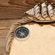 Old paper, compass, and model classic boat on wood background — Foto Stock