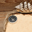 Old paper, compass, and model classic boat on wood background — 图库照片