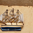 Old paper, compass, and model classic boat on wood background — Stock Photo #4601774