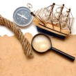 Rope, loupe, compass and model classic boat — Stock Photo