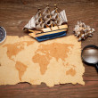 Stock Photo: Model classic boat, compass and loupe on wood background