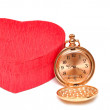 Red box hearts with a pocket watch — Stock Photo