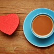 Cup of coffee and red box in heart shape — Stock Photo #4699064