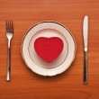 Red heart on a white plate — Stock Photo #4699282