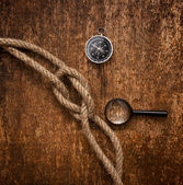 Compass, magnifying glass and rope — Photo