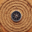Rope coil with compass in the center — Stock fotografie