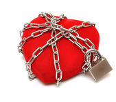 Love locked heart shape with chains — Stock Photo