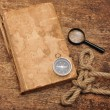 Stock Photo: Old book and compass
