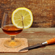 Classic cognac with lemon and knife — Stock Photo
