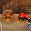 Stock Photo: Pipe and glass of cognac